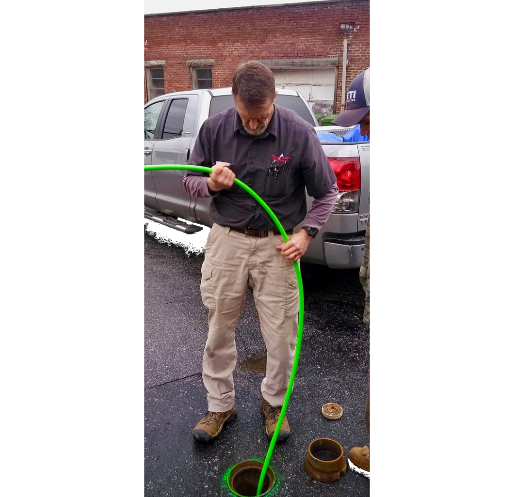 plumber working on the sewer